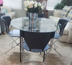 Glass Table Metal Crossed Black Legs & 4 Acrylic Chairs for Sale in Arvada, CO