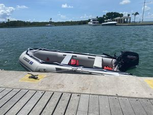 New Boat inflatable 12ft - New motor Suzuki 15HP with trailer. for Sale in Miami, FL