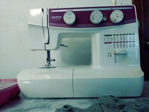 Sewing machine with attachments for Sale in Norfolk, VA