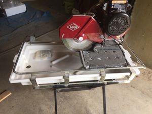 MK Diamond MK-100 10 inch table saw with stand for Sale in Tualatin, OR