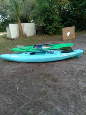 Sundolphin 10 ft and pelican 10 ft kayak both with paddles for Sale in Inverness, FL