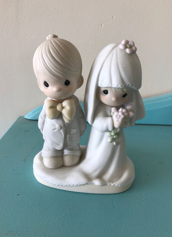 Precious Moments Bride and Groom—would make an adorable cake topper