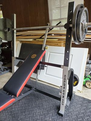 Olympic bench with pulley system and leg and biceps attachments. 240 lbs of olympic plates and a 45 lbs olympic bar. for Sale in Snellville, GA