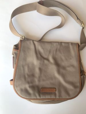 Dooney and Burke crossbody messenger bag tan for Sale in Clermont, FL