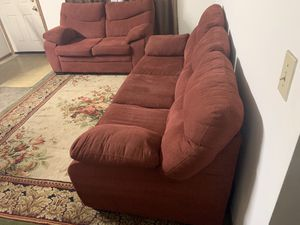 Couch it's nice and clean it's both red suede nothing wrong no rips or stains no pets or smoke it's very comfortable for Sale in Columbus, OH