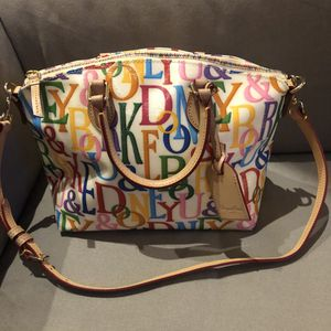 Dooney & Burke White Leather Satchel with colored lettering all over for Sale in Annandale, VA