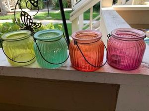 Pier 1 gem colored glass jars w handles $10 for Sale in Los Alamitos, CA