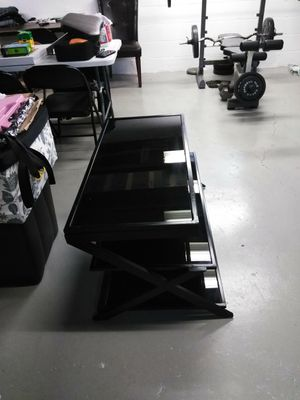 BLK shinning glass tv stand hold up 55 to 60 inches . for Sale in Dearborn, MI