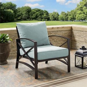 Crosley Furniture Kaplan Arm Chair In Oiled Bronze With Mist Universal Cushion Cover DESCRIPTION: Add simple elegance to your outdoor area with the K for Sale in Houston, TX