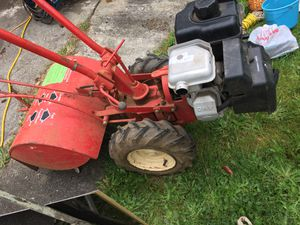 Troy built roto tiller 10 hp with plow, tire chains for Sale in Sherwood, OR