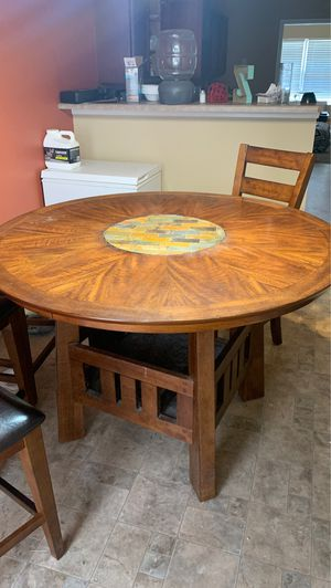 Nice wooden kitchen table with built in storage and lazy Susan for Sale in Nashville, TN