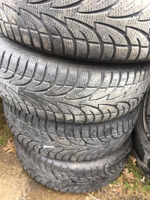 4 steel rims and decent snow tires off of a Dodge Journey for Sale in Cleveland, OH