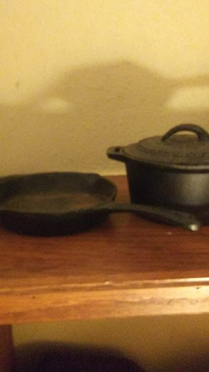 John Wayne Cast Iron sauce pot w/ lid, and 6in. Cast iron skillet. for Sale in Blanchard, OK