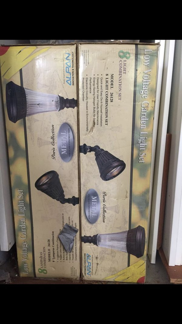 2 sets of brand new never used 8 low voltage garden lights