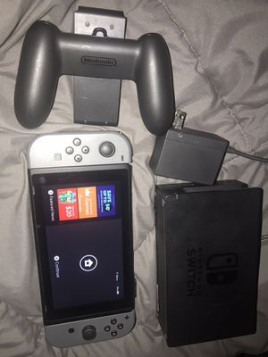 Nintendo Switch W/Dock, Charger,Joycons ,Grip Gray / Black for Sale in Whittier, CA