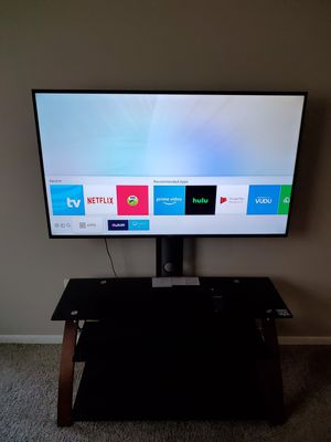 50 inch Samsung Smart TV and entertainment center for Sale in New Hradec, ND