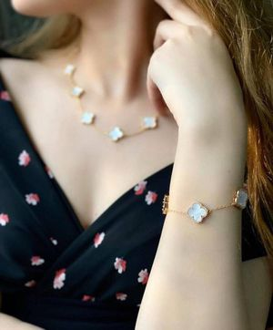 Set white necklace and Braclet gold plated for Sale in Dearborn, MI