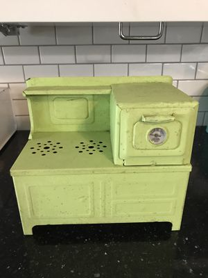 Antique metal doll stove. for Sale in Edgewood, WA