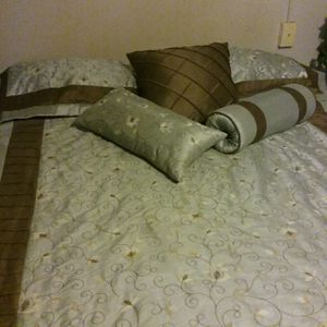 Queen size comforter seafoam green and brown stitch work 2 shams 3 decorative pillows and dust ruffle for Sale in Greenville, SC