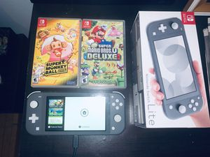 NINTENDO SWITCH LITE + games for Sale in Chicago, IL
