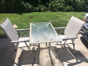 patio furniture glass table and two folding chairs for Sale in PT CHARLOTTE, FL