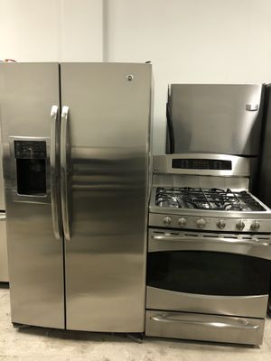 GE side by side stainless steel refrigerator & GE 5 burner double oven stainless steel stove for Sale in Chicago, IL