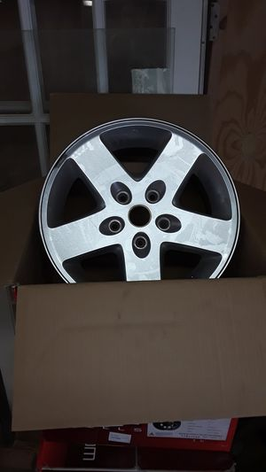 Jeep stock wheels and lugs for Sale in St. Petersburg, FL
