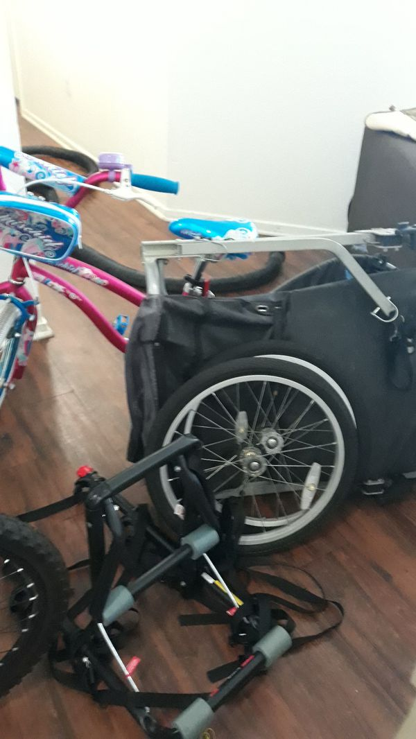 Havoc fs hyper, schwinn ranger fs, boys bike with no brakes, girls bike, bike holder, and a bike trailer.