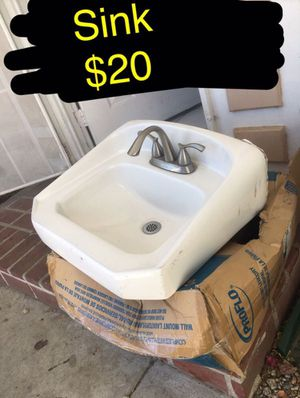 Used sink and faucet. Nickel brush finish on faucet. Faucet new is $80. Come with back plate to hang on wall for Sale in Ontario, CA