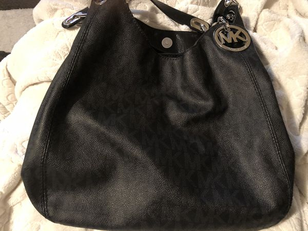 Michael Kors black leather hobo bag/ slightly used