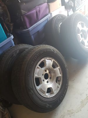 Chevy stock rims/New tires for Sale in Holland, MI