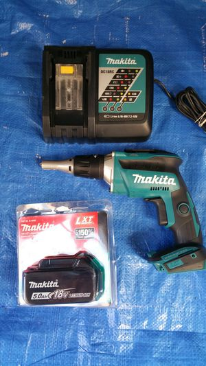 $250 . Makita Brushless Drywall screwgun+ 5.0ah Battery+ charger for Sale in Evergreen, CO