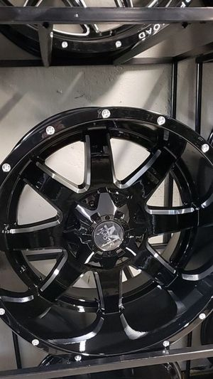 20x12 black monster rims 6 lug 6x139 6x5.5 6x135 on new mud tires 33 1250 20 for Sale in Phoenix, AZ