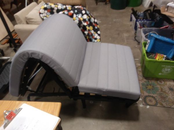 Lounge chair futon style turns into cot