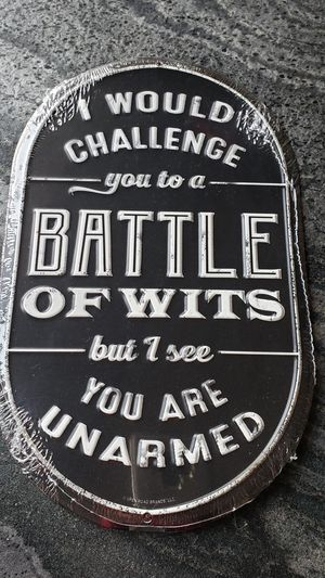 """ I would challenge you to a battle of wits but I see you are unarmed"" funny embossed black and white metal sign home decor. Easy to hang for Sale in Ontario, CA"