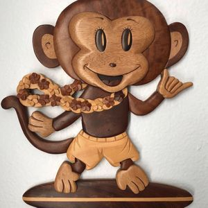 Adorable carved wooden monkey from Hawaii. Measures 11h x 9w x 1/4' deep. This is wall art, not a free standing item for Sale in Tampa, FL