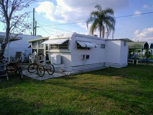Rolls trailer with sunroom.andbass boat.with two car ports for Sale in Frostproof, FL