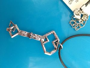 AntiQue SiLveR KeY Dangle Triangle Charm NecKLaCe for Sale in North Salt Lake, UT