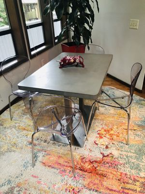 Breakfast dinning set. Concrete and Metal table with 4 clear chairs for Sale in El Cajon, CA