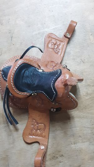 Cute tiny decor saddle (hand it from a car rearview mirror( for Sale in Kennewick, WA