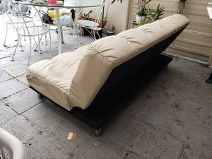 Selling beige leather futon sofa bed for Sale in Miami, FL