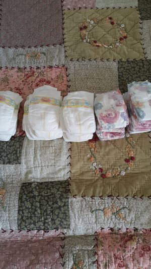 30 Newborn Pampers and Honest Diapers for Sale in Arlington, WA