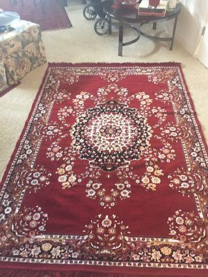 Never used ,classic Persian style Rug 5'x8' by Ashley excelents conditions for Sale in Ashburn, VA