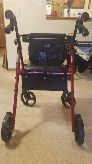 Elite Brand push Walker with hand brakes and seat to sit also storage compartment. Used only 1 month. Selling for $75 firm total. for Sale in INVER GROVE, MN