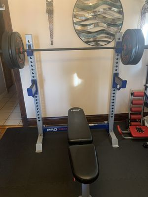 NEW OLYMPIC WEIGHT BENCH WITH RACK WEIGHTS AND BAR NOT INCLUDED for Sale in Chicago, IL