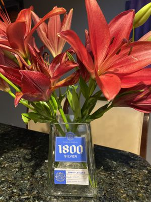1800 tequila silver glass bottle flower vase or holder for Sale in Las Vegas, NV