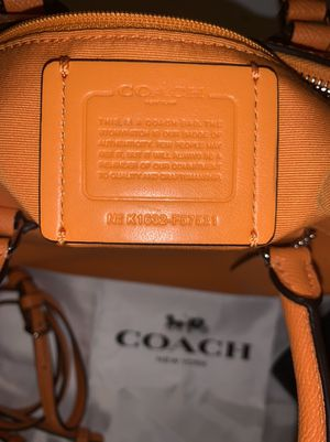 Orange Coach handbag and dark blue wallet (authentic) for Sale in Plant City, FL