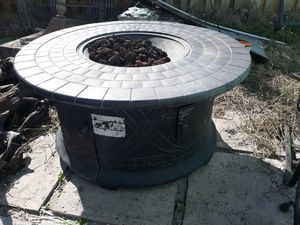 Extremely heavy very large fire pit takes propane tank underneath for Sale in West Palm Beach, FL