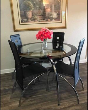 Barely used elegant black dining table with 4 leather chairs for Sale in Las Vegas, NV