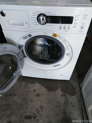 Ge 24inch front load washer works good 1yr warranty for Sale in Fort Washington, MD